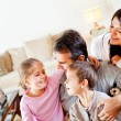 Happy family at home — Stockfoto #9774165