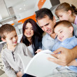 Family reading a book - Stock Photo