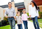 Family outside home — Stock Photo