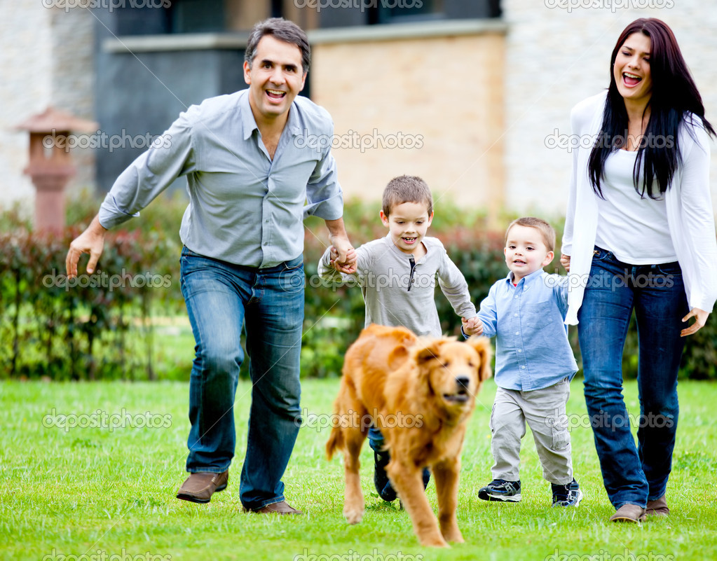 Happy family running at the backyard and having fun — Stock Photo #9774142