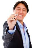 Businessman holding a pen — Stock Photo