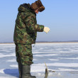 Stock Photo: Ice fishing