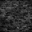 Dark brick wall texture or background — Stock Photo