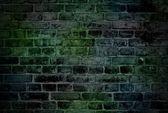 Rough dark green brick wall — Stock Photo