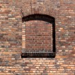 Bricked window in a brick old wall — Stock Photo