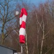 Red with white windsock — Stock Photo