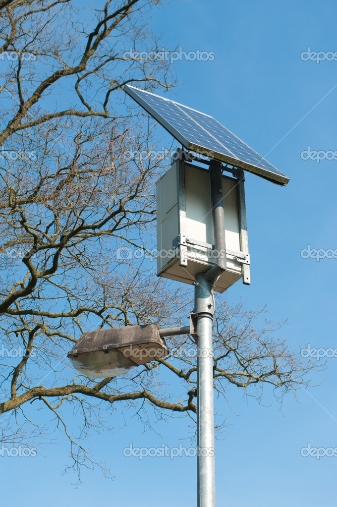 Street light powered by a solar panel — Stock Photo #10423697