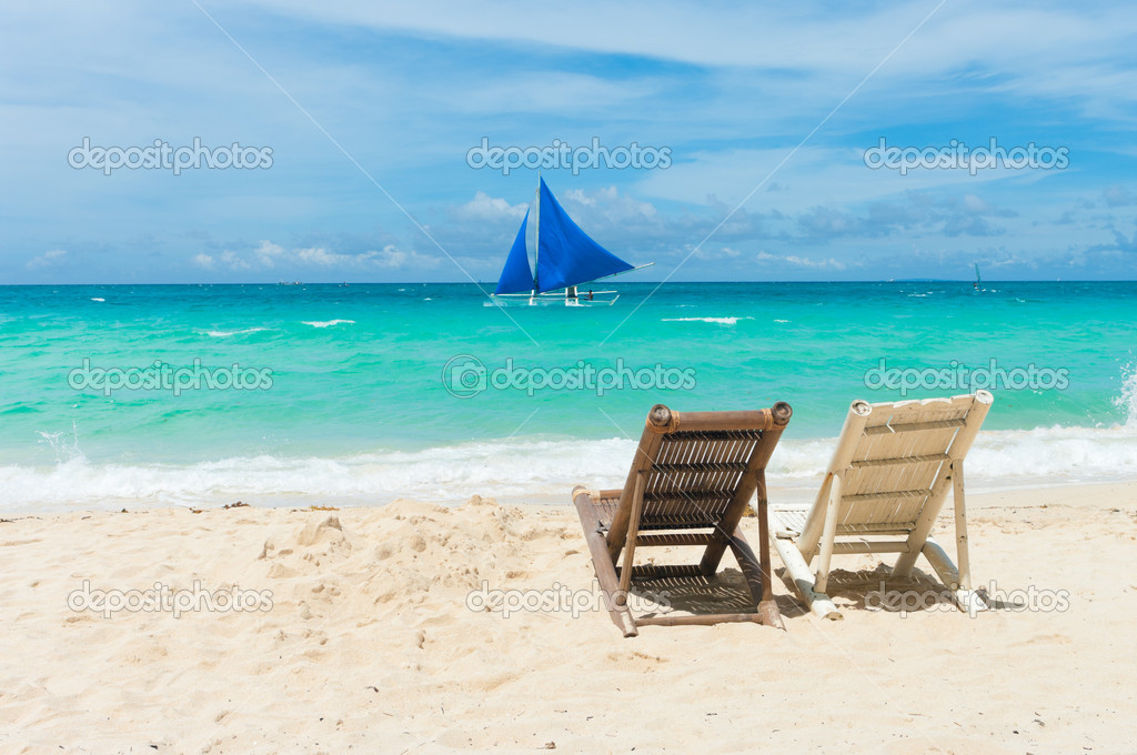 Tropical beach with two beach chairs facing the blue sea — Stock Photo #9046376