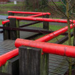 Foto Stock: Red handrail