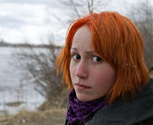 Sad redhead girl looking to the side — Stock Photo