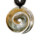 Stone pendant orange tint in the shape of a helix. Isolated, clo — Stock Photo