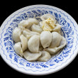 The blue patterned plate full of dumplings, seasoned with a piec - Stok fotoğraf