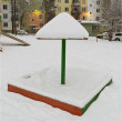 "Children's sandbox with lid, ""fungus"" covered with snow — Stockfoto #8373946"