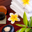 Spa concept with zen stone, bath salt, soap and two yellow flowe — Stock Photo
