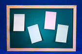 Chalk board with four sticky notes — Stock Photo