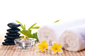 Spa concept with black zen stones and flowers — Stock Photo