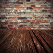 Brick wall and wood floor background of old cellar — Stock Photo