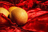 Christmas balls on red background with empty space for text — Stok fotoğraf