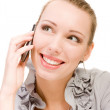 Smiling beauty businesswoman calling by mobile phone on white background — Stock Photo