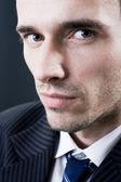 Handsome man portrait, male model, studio shot, dark background — Stock Photo