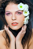 Beauty woman glamour portrait, makeup presentation, white flowers, studio s — Stock Photo