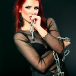 Sexy red hair beauty rock and roll woman, girl, model in black with chains — Stock Photo