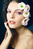 Fashion portrait of female model - beauty girl woman with flowers in her ha — Stock Photo