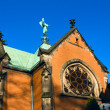 Gothic catholic church with angel on blue sky, Swierklaniec, Poland, Europe - Stock Photo