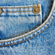 Worn blue denim jeans trousers pocket as texture or background to insert te — Stock Photo