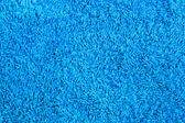 Blue carpet texture as background to design — Stock Photo