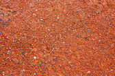 Real texture of small red stones as red background to design — Stock Photo
