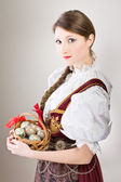 Model girl in traditional clothes (Poland / Silesia) with easter eggs in wi — Stock Photo