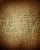 Aged yellow fabric as vintage background for insert text or design — Stock Photo