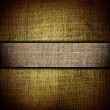 Stock Photo: Grunge dark yellow fabric with brown bar as vintage background for insert text or design