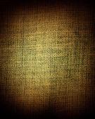 Grunge donker gele stof als vintage achtergrond voor tekst of ontwerp invoegen — Stockfoto