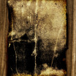 Dark old paper on wooden board — Stock Photo