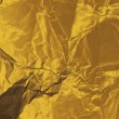 Crumpled gold paper — 图库照片