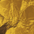 Crumpled gold paper — ストック写真