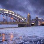 Bolsheokhtinsky Bridge through the Neva River in St. Petersburg. — Stock Photo #10668290
