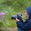 Stock Photo: Little boy is photographing nature.