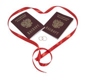 Two passports, two golden rings in red heart, isolated. — Stock Photo