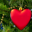 The Christmas-tree decoration in the form of red heart. — Stock Photo