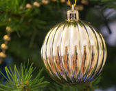 The Christmas-tree decoration in the form of golden ball. — Stock Photo