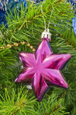The Christmas-tree decoration in the form of six-final purpur st — Stock Photo