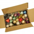 Box with a Christmas tinsel and New Year's toys. — Stock Photo