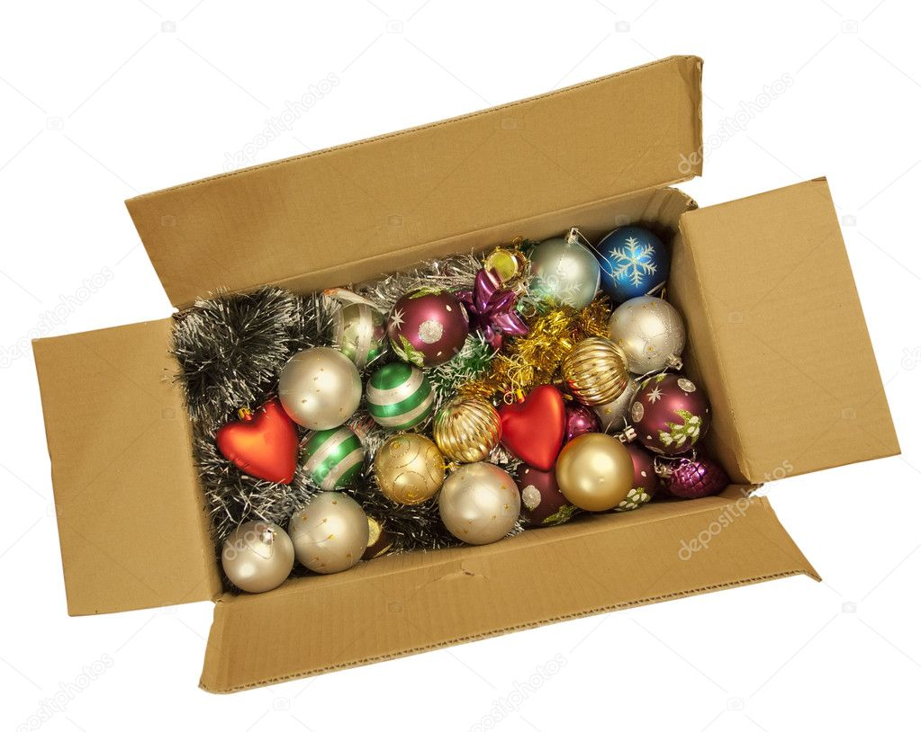 Box with a Christmas tinsel and the New Year's toys, isolated on a white background. — Stockfoto #9347453