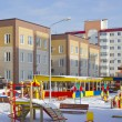 New kindergarten with a playground and new multi-storey building — Stock Photo