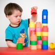 Two years child with colorful construction set — Stock fotografie
