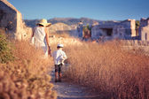 Mother and her little son walking in ancient city — Stock Photo