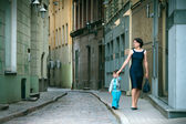 Mother and her little son walking in city — Stock Photo
